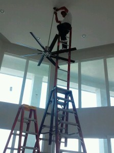 Horacio Castro completing the installation of a ceiling fan in a new home in South Fort Myers.